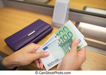 hands with money at bank or currency exchanger - people,...