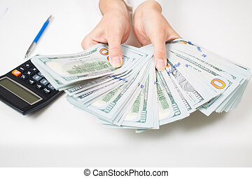 Hands with money. American dollars