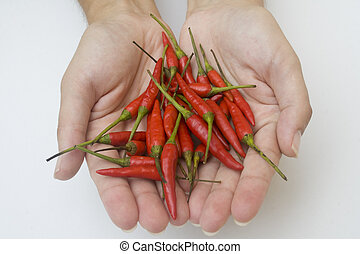 Hands with peppers
