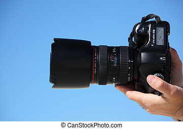 hands with photo camera