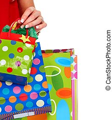 Hands with shopping bags. - Hands of beautiful girl with...