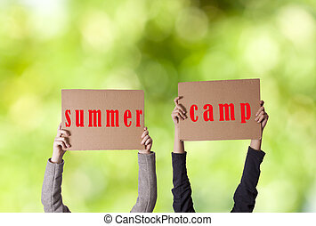 hands with sign summer camp