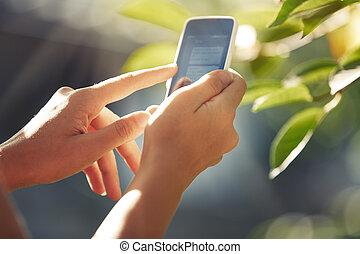 Hands with smartphone