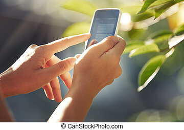 Hands with smartphone