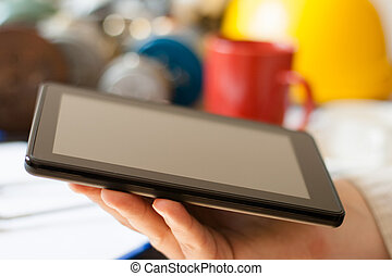 Hands with tablet computer