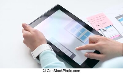 hands with tablet pc working on user interface - technology...