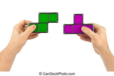 Hands with tetris toy blocks isolated on white background