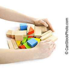 Hands with wooden block toys