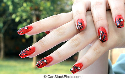 Hands - Woman hands with nail art fingers.
