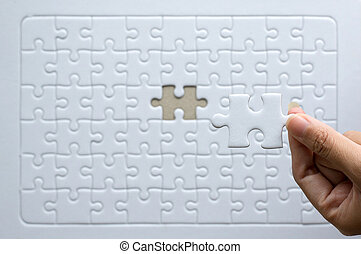 Hands women with jigsaw puzzle white color, Puzzle pieces grid, Success mosaic solution template