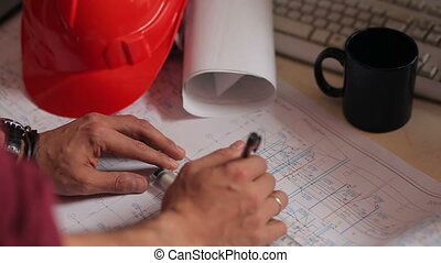 hands work with the drawings and blueprints