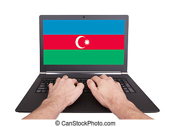 Hands working on laptop, Azerbaijan