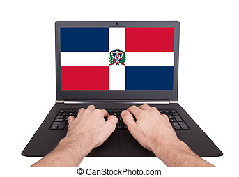 Hands working on laptop, Dominican Republic