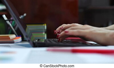 hands working on laptop