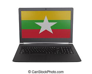 Hands working on laptop, Myanmar
