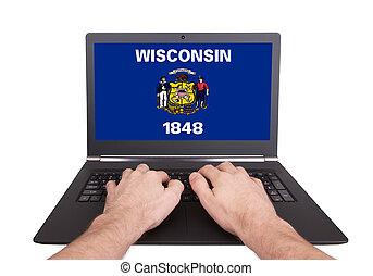 Hands working on laptop, Wisconsin