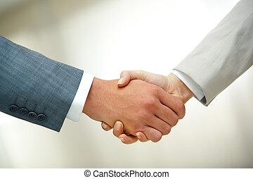 Handshake after striking deal - Photo of handshake of...