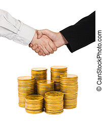 Handshake and stacks of coins isolated on white background