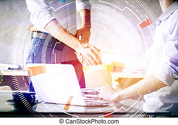Online business concept - Handshake at workplace with...