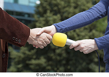 Handshake before media interview