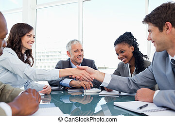 Handshake between a businesswoman and a co-worker when a...