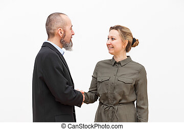 handshake between man and woman