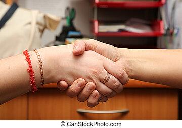 handshake between two person