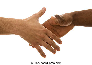 Handshake - Black and white hands shaking in friendly...