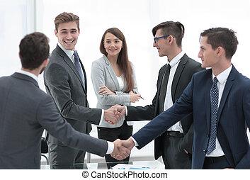 handshake business competitors before starting negotiations
