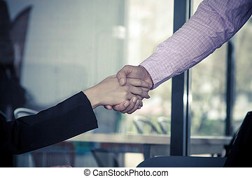 Handshake business concept,  Businessman and businesswoman shaking hands, because they have become new partners
