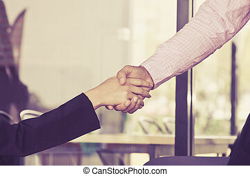 Handshake business concept, Businessman and businesswoman shaking hands, because they have become new partners in cafe