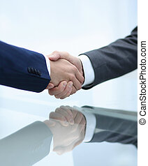 handshake business partners closeup