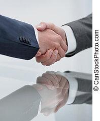 handshake business partners closeup