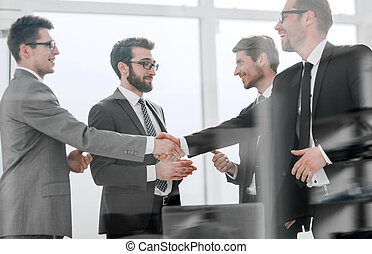 handshake business partners standing in the office