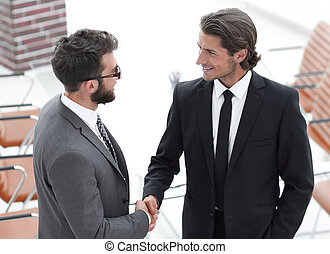 handshake business partners to the conference room