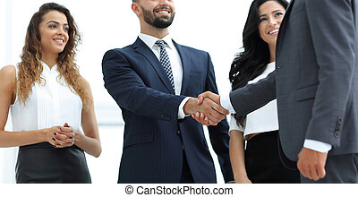 handshake business people at meeting