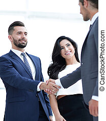 handshake business people at meeting