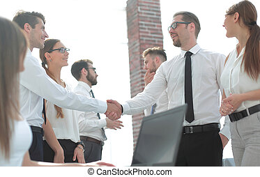 handshake business people in a modern office