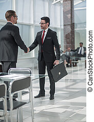 handshake business people in the Bank office