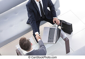 handshake business people in the workplace.