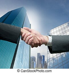 Handshake - Business people shaking hands over a deal