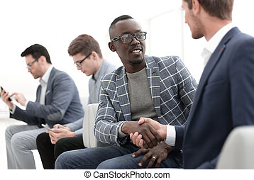 handshake business people sitting in the office