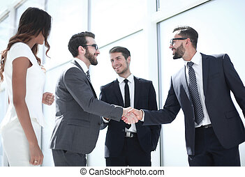 handshake business people standing in the office.