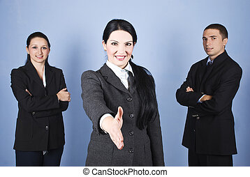 Handshake business woman and her team - Three business...