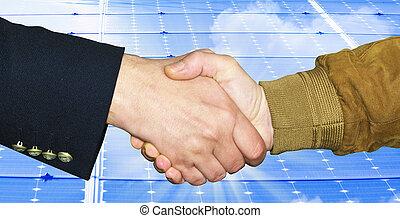 Handshake close up on light blue background