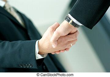 Handshake - Closeup of business people shaking hands over