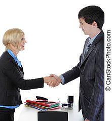handshake happy business partners in the office.