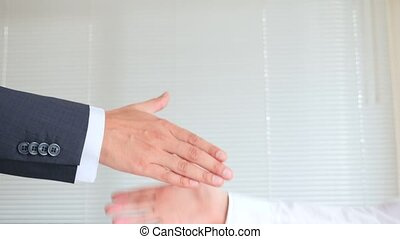 Handshake in business, man and woman shake hands. 4k, slow motion
