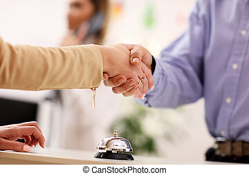 Handshake in hotel reception