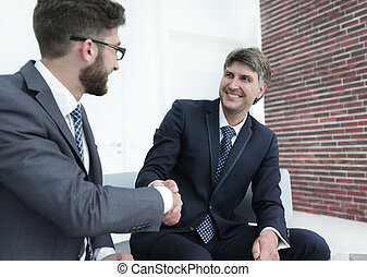Handshake manager and attorney in the office
